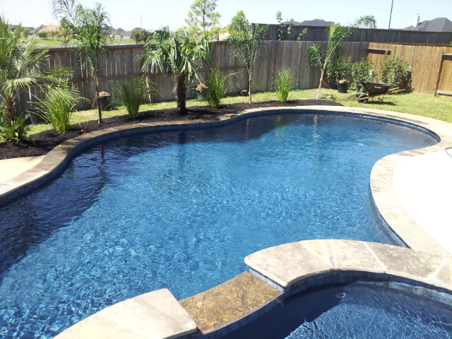 Barbedos Blue with travertine coping